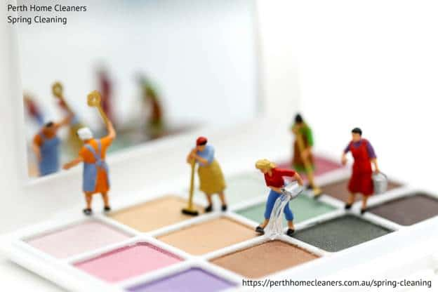 spring cleaning figurines on makeup tray