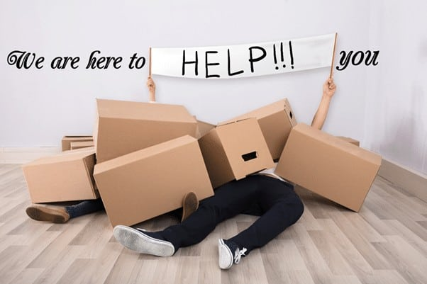 cardboard boxes fallen on people with caption we are here to help you
