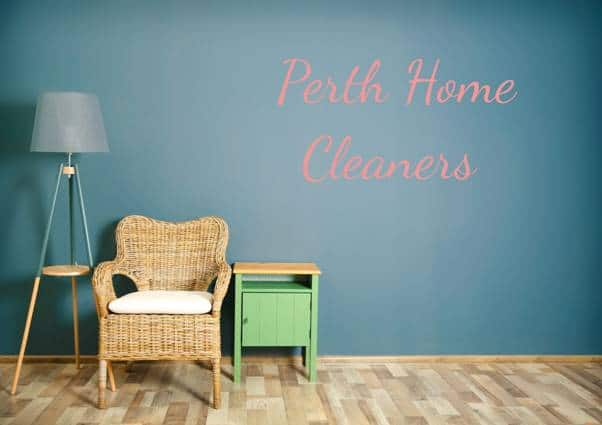 """wicker chair, lampshade and side table on wooden floor with caption """"Perth Home Cleaners"""""""