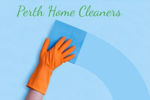 The orange-gloved hand of a person is wiping away dirt in a curved motion from the blue background using a blue sponge, leaving behind a clean, darker blue trail. The words Perth Home Cleaners are above that area in green
