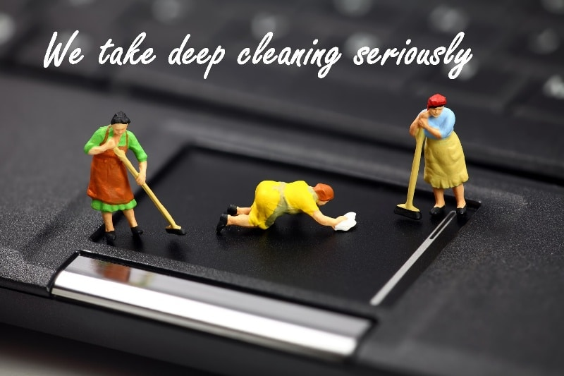 Three plastic figures of people cleaning the trackpad of a laptop. The caption is We take deep cleaning seriously