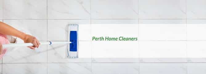 overhead view of a person mopping grey tiles, leaving a white trail that contains the words Perth Home Cleaners