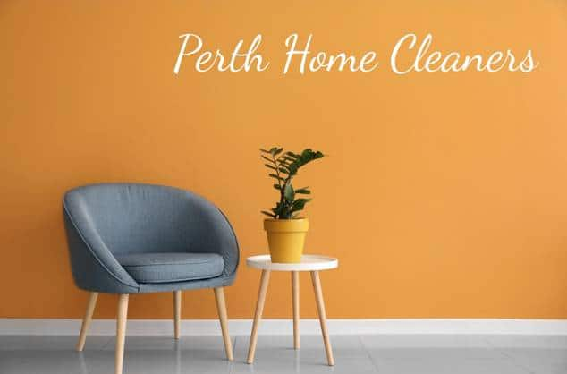 comfortable chair, pot plant and an orange wall with the words Perth Home Cleaners