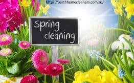 spring cleaning sign in a bed of colourful flowers