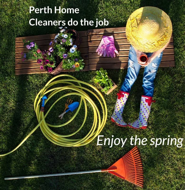 overhead view person with big hat sitting, holding a drink, surrounded by gardening supplies